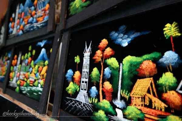 lukisan jam gadang di Ngarai Sianok